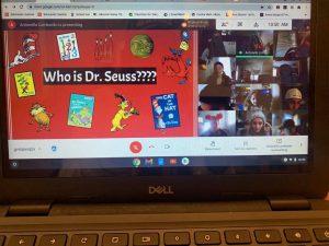 Google meet of kids being read Dr Seuss book