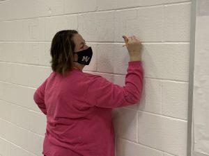 Vicki painting mural