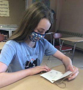 girl reading card