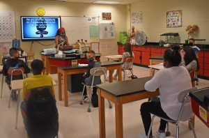 teacher in science classroom with students