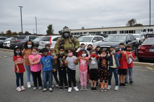 Firefighter with students